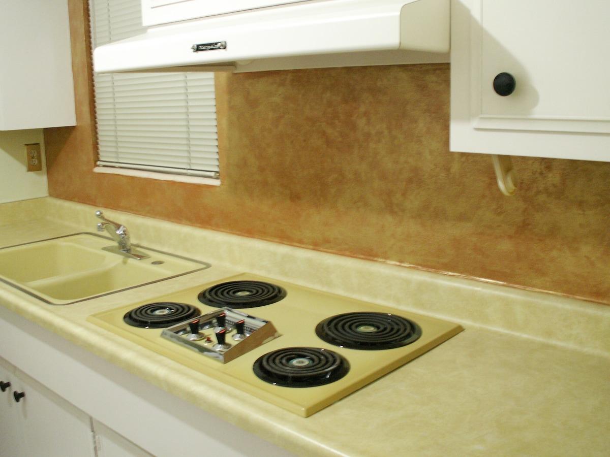 electric range, also find microwave, coffee maker, W/D, blender