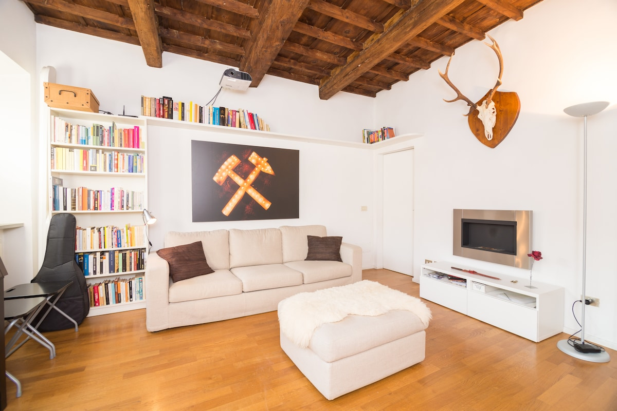 living room with stag and bio-fireplace (beware: real flames!)