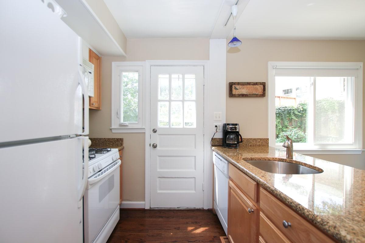 Kitchen with Gas stove, full fridge, and dishwasher