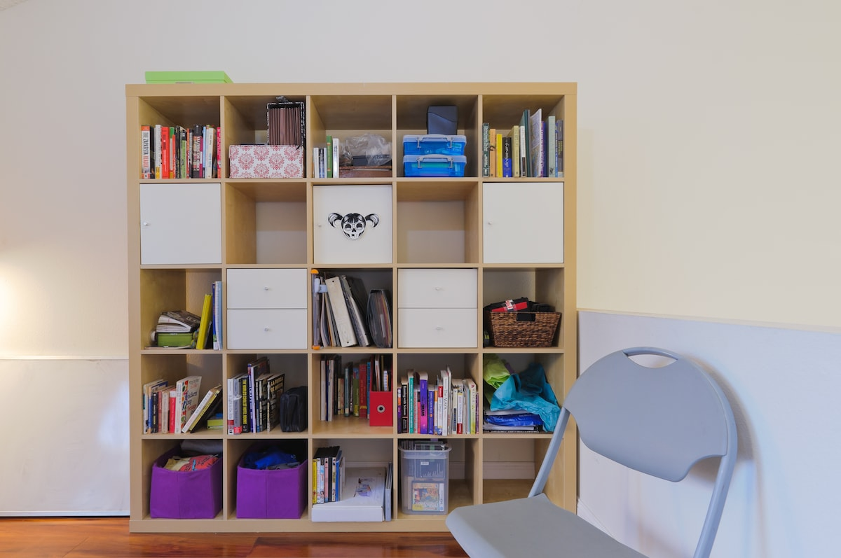 Bookshelf with room to share for your things.