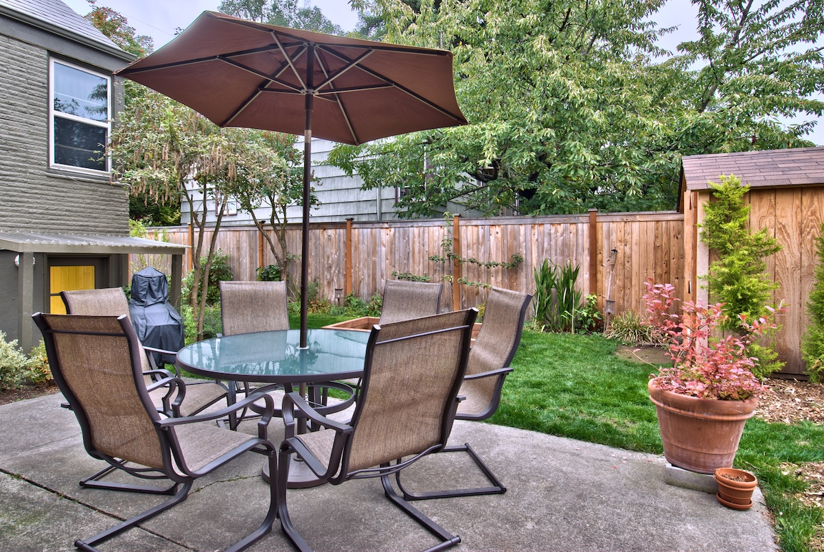outdoor relaxation with gas grill and a sandbox for the little ones.