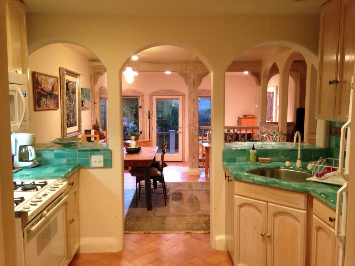 Beautiful aquamarine tiles in the well equipped kitchen, a dining area and separate sunken living room area