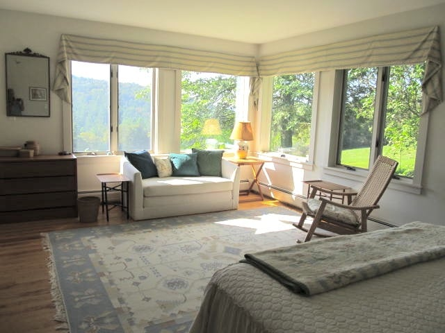 Master bedroom in summer looking South, with loveseat and rocker