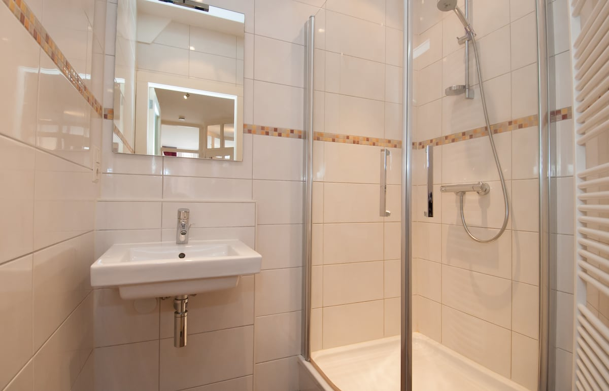 Modern new bathroom with shower and sink (there is a separate toilet)