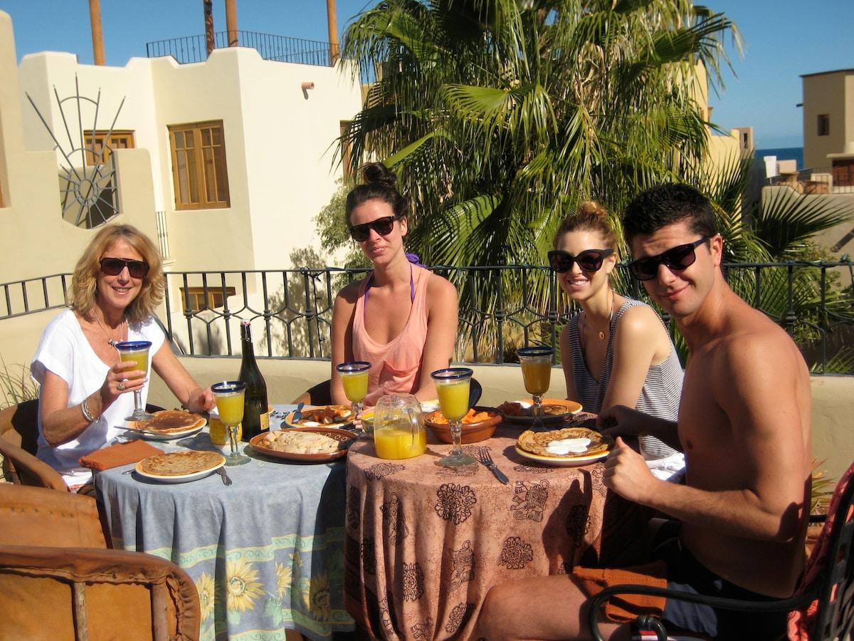 Sunny upper deck breakfast overlooking palm treed courtyard