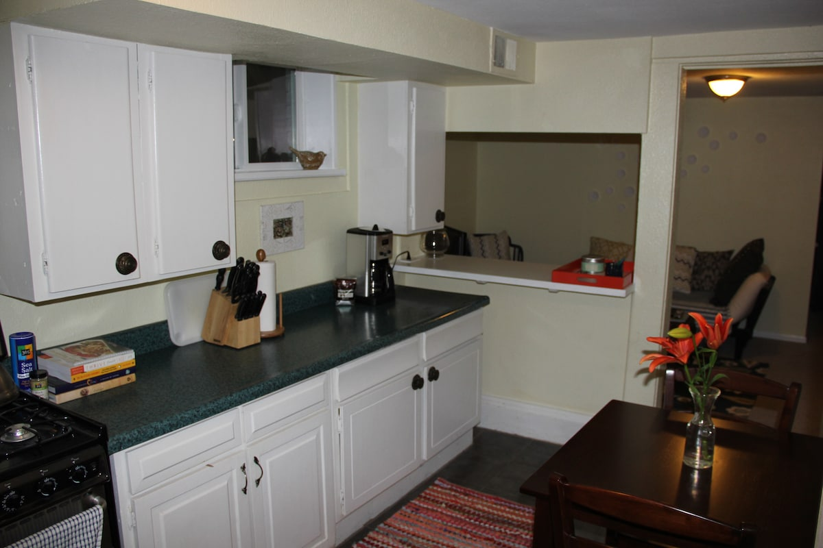 The kitchen is fully stocked with everything you'll need to prepare and enjoy a meal.