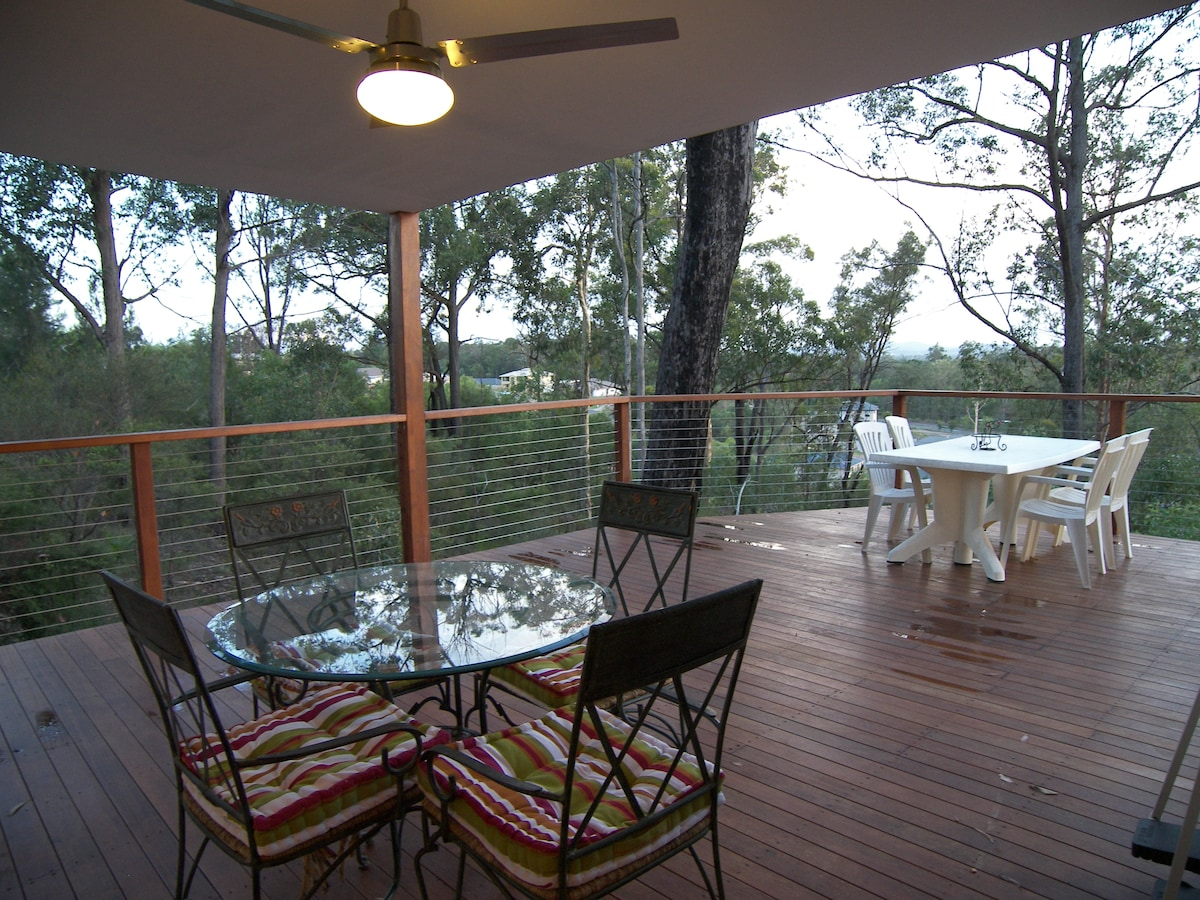 Great deck with bushland and treetop views. City lights at night