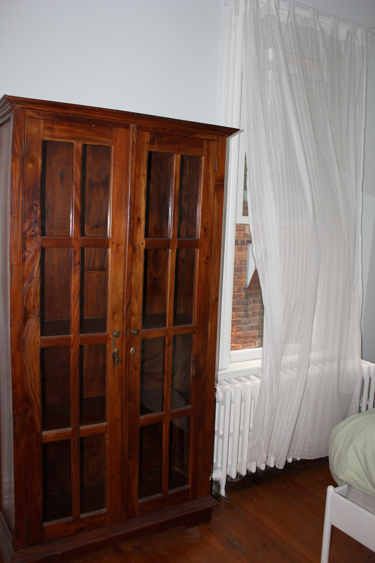 Armoire for your things, next to window - great view of brick wall next door - sun still shines in!