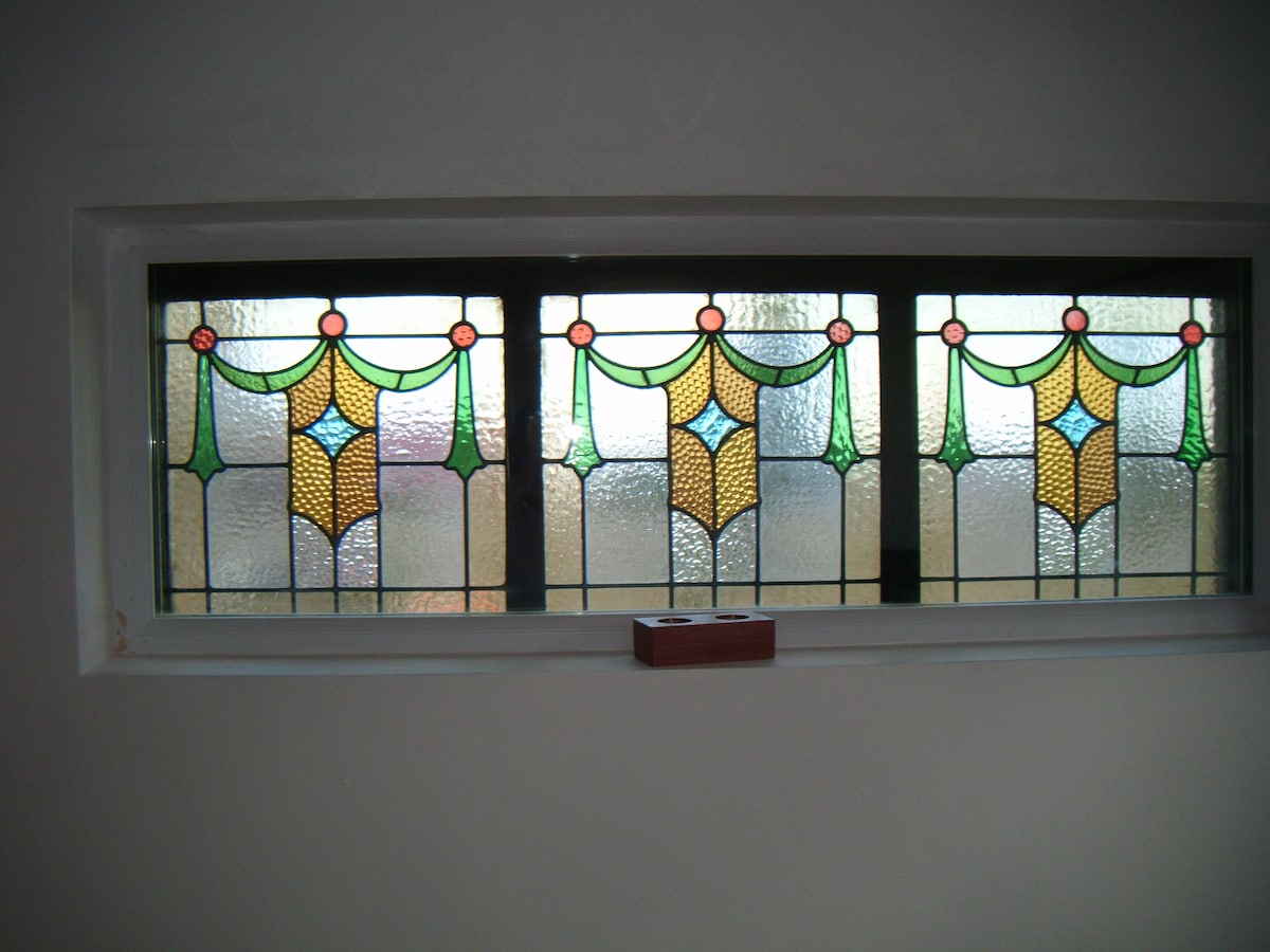 Stained glass salvaged from the original house.