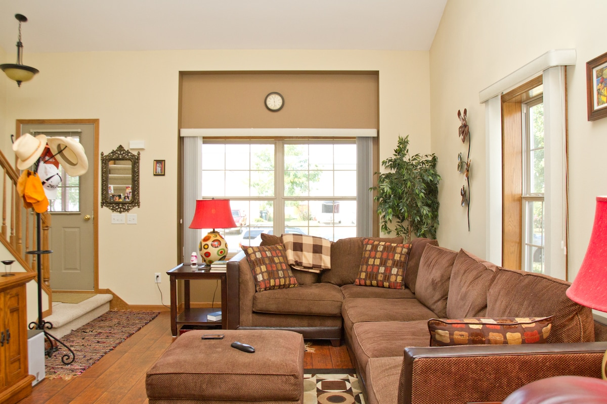 The Living room features natural lighting to enjoy the comforts of lounging on a couch with plenty of room for all!
