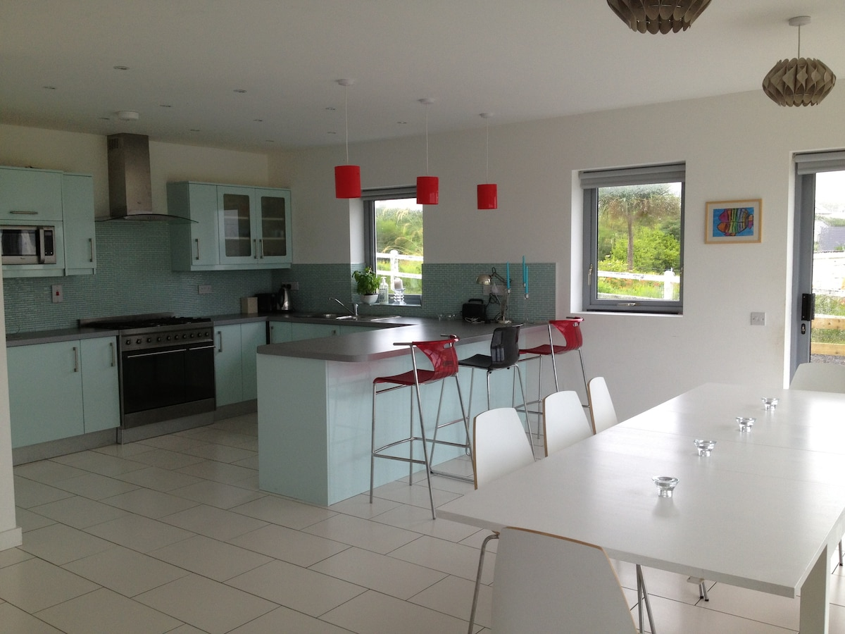 Large kitchen, dining room with breakfast bar and larder