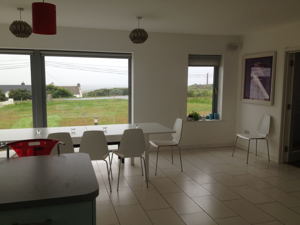 Sea views from Kitchen/Dining room and sound system.