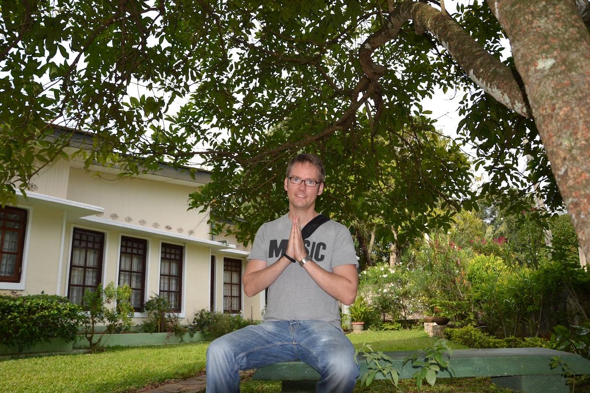 Arne enjoying the shade from our Rambutan tree