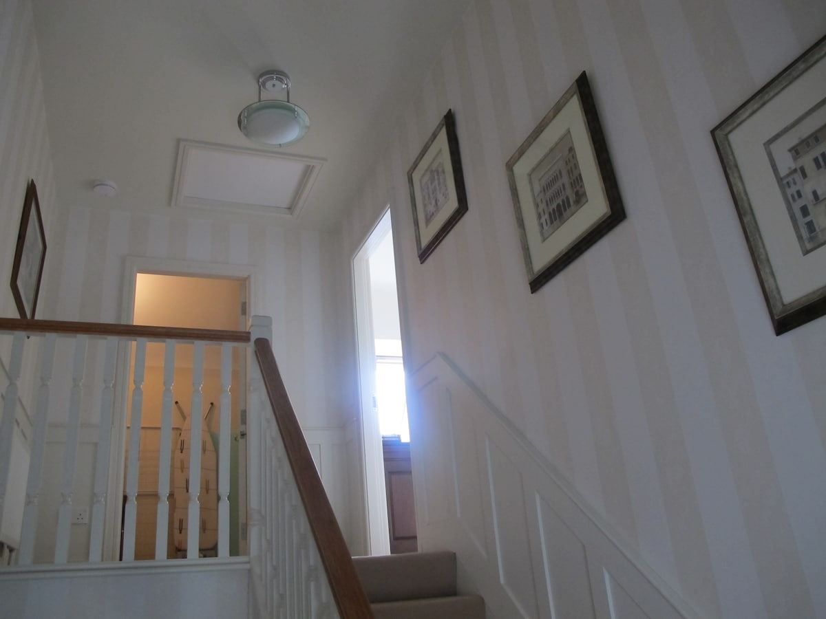 Looking up to the mast bedroom from the bottom of the stairs
