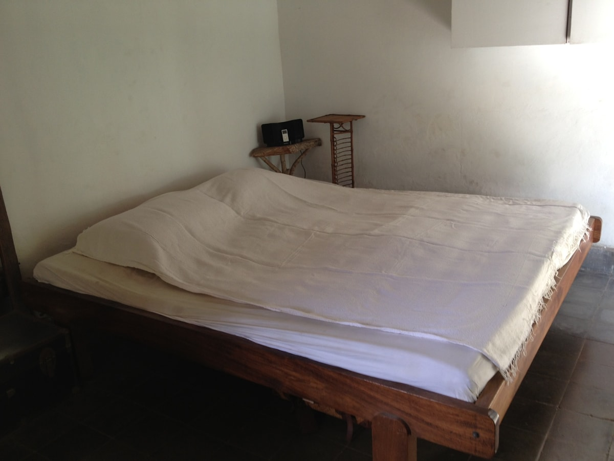 A super king sized bed with a cool kapok mattress and ipod dock