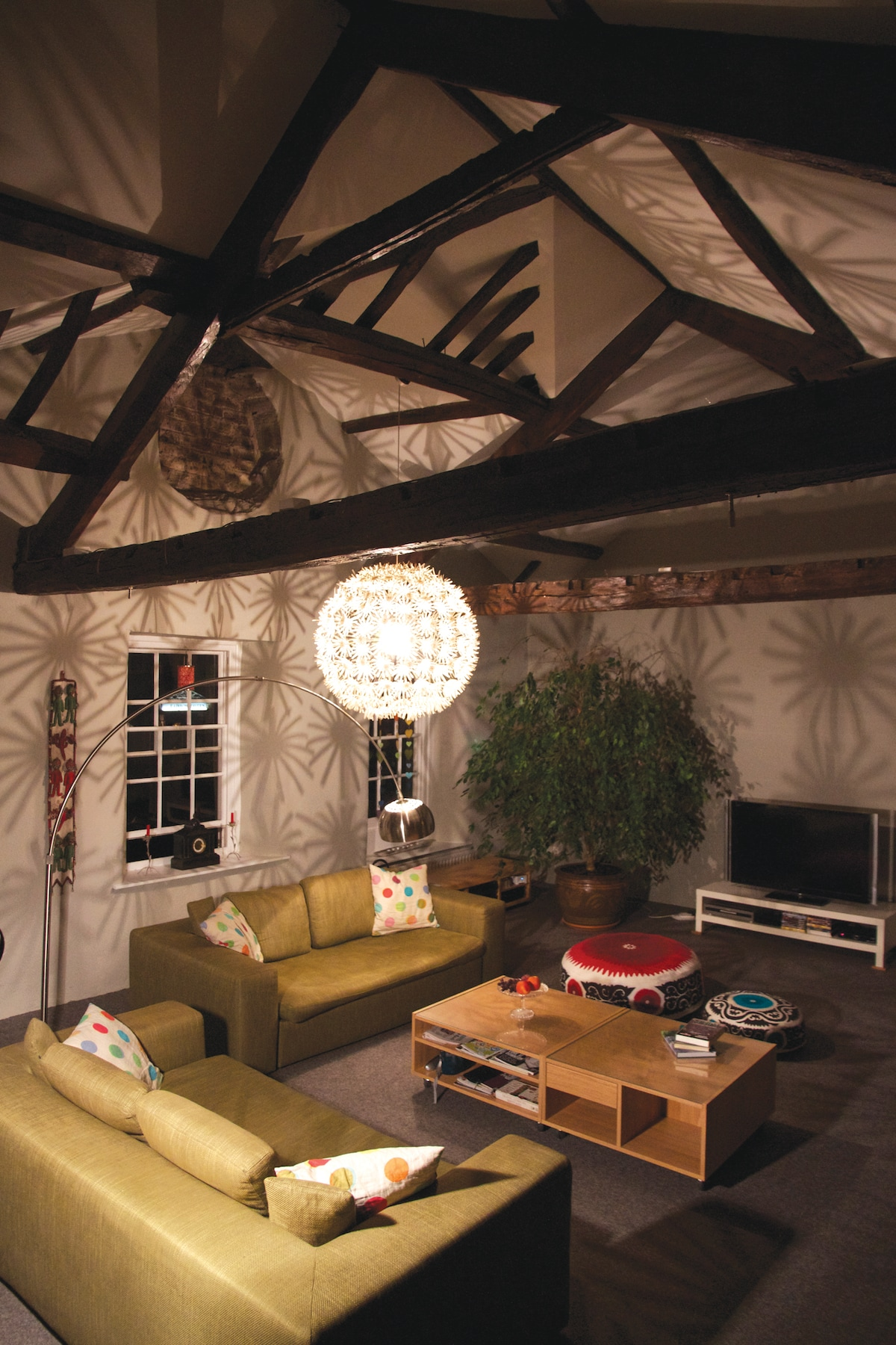 Living room with double height beamed ceiling