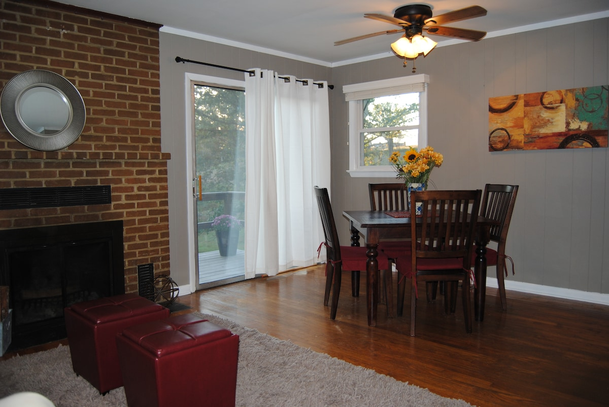Open concept living room and dining room.  Sliding glass door leads to deck.