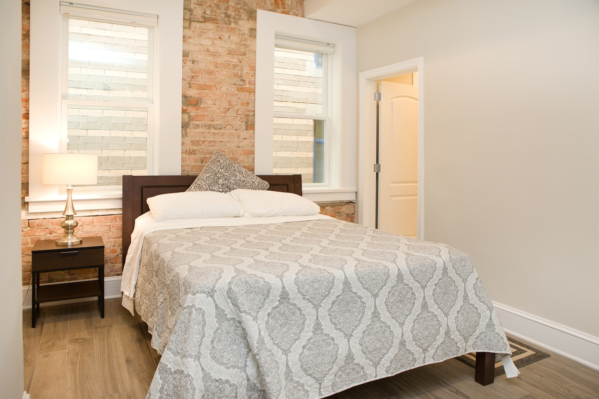 Large bedroom with a Queen sized bed, lot of closet space and walk-in storage.