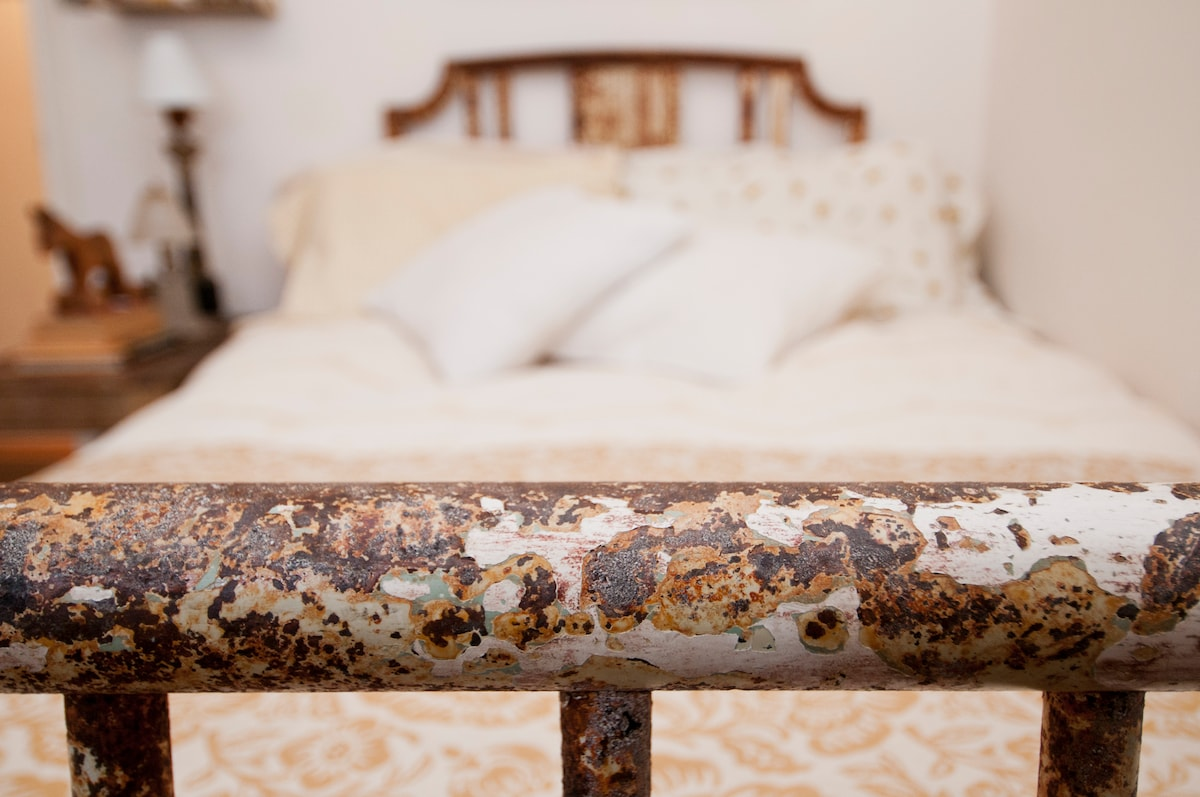 a beautiful antique bed with a size FULL mattress :)