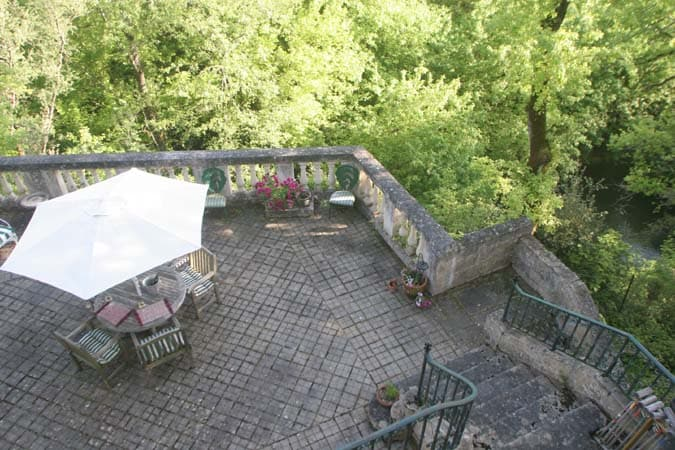 Secluded terrace leading off french doors  which overlooks the River.