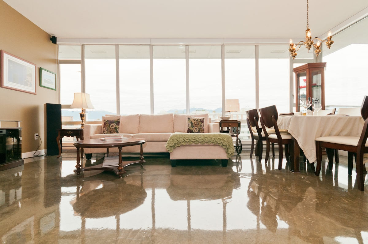 Expansive living area with polished concrete floors.