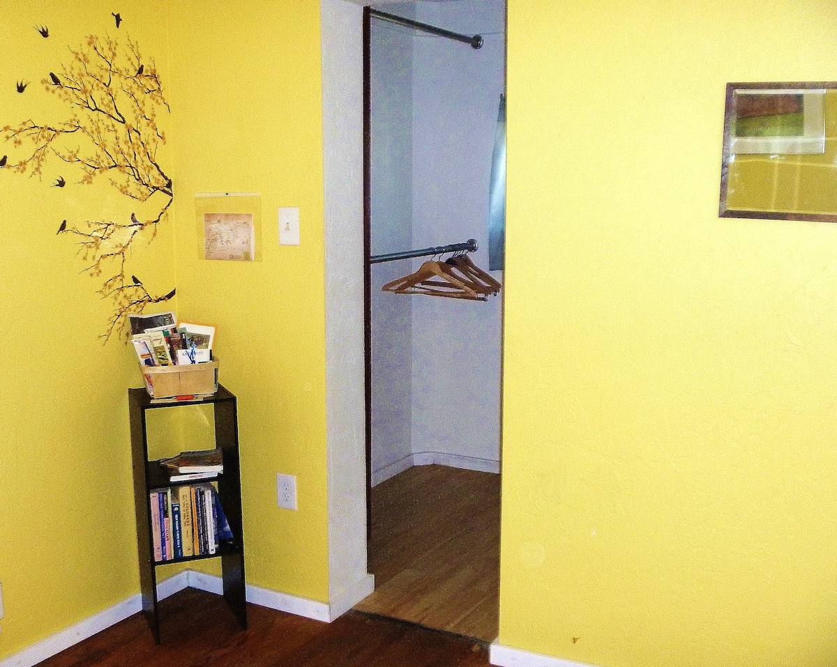 Walk in closet in guest room with guide books, maps, local coupons