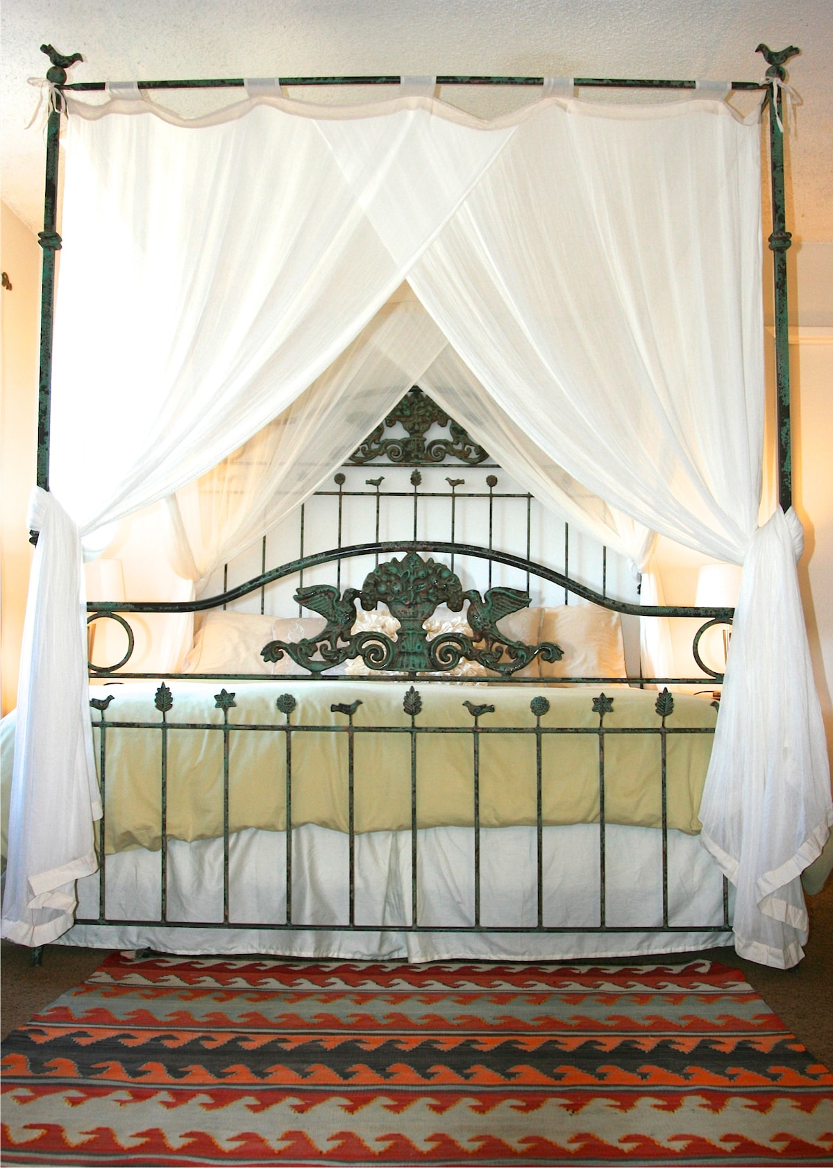 Just upgraded, Canopy King bed with view of front garden.