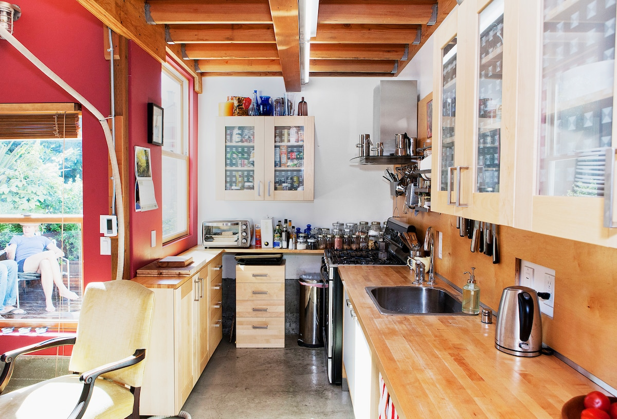 The kitchen has stainless steel Bosch appliances and lots of counter space.