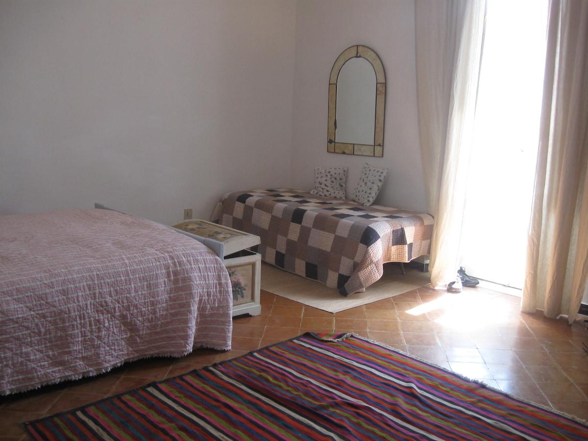 The main bedroom with balcony