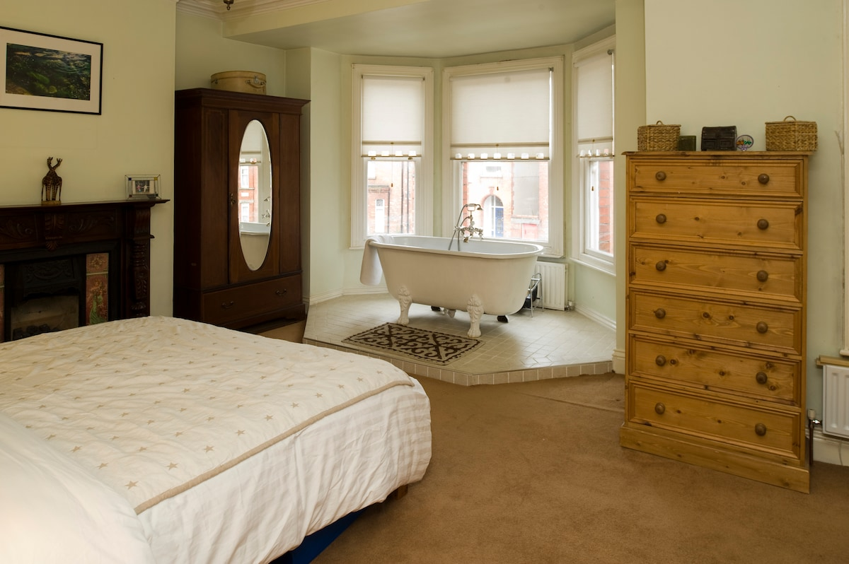 From this huge master bedroom it will be difficult to get going in the morning!