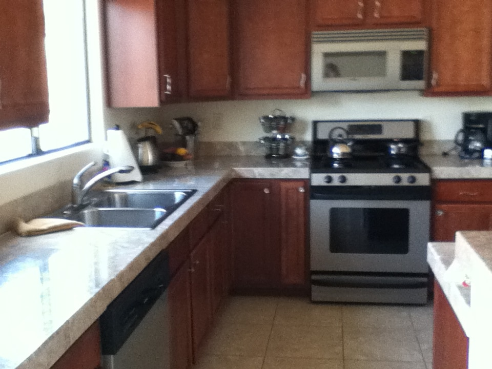 Kitchen with all amenities included, bright windows leading to creek view, gas stove, microwave, dishwasher plus bar seating area off the kitchen not in view.