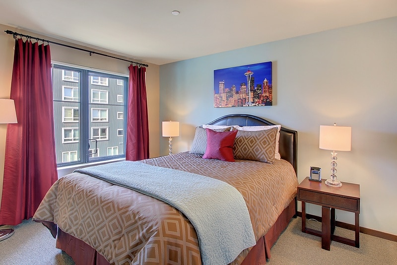 Bedroom featuring Comfortable Queen Sized bed with high thread count sheets and sizeable closet