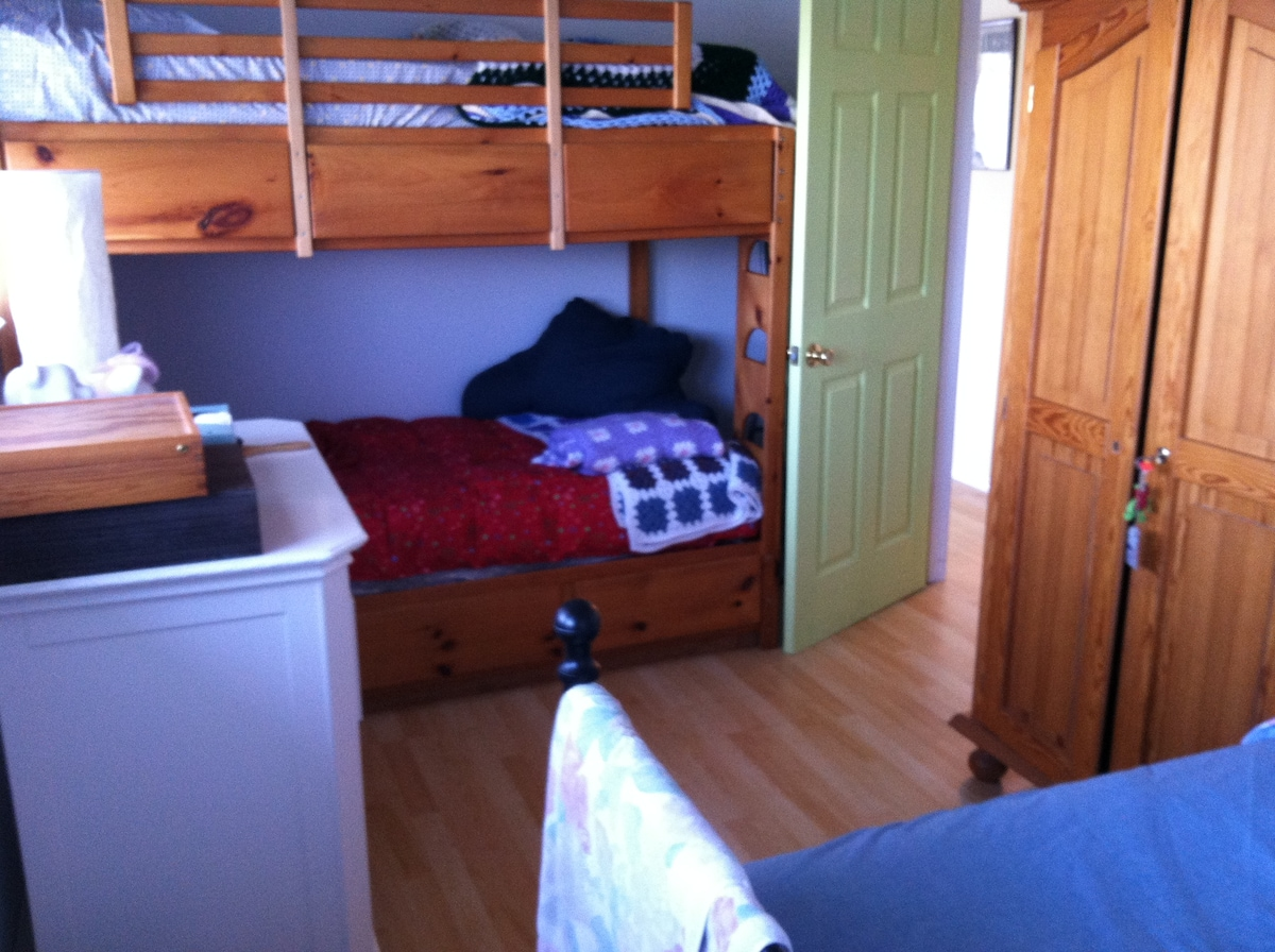 Bedroom 2 with bunk bed and full size bed.