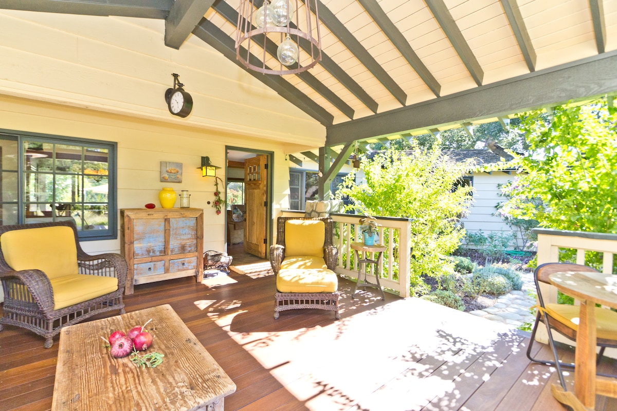 Mahogany-decked front porch - our favorite outdoor room