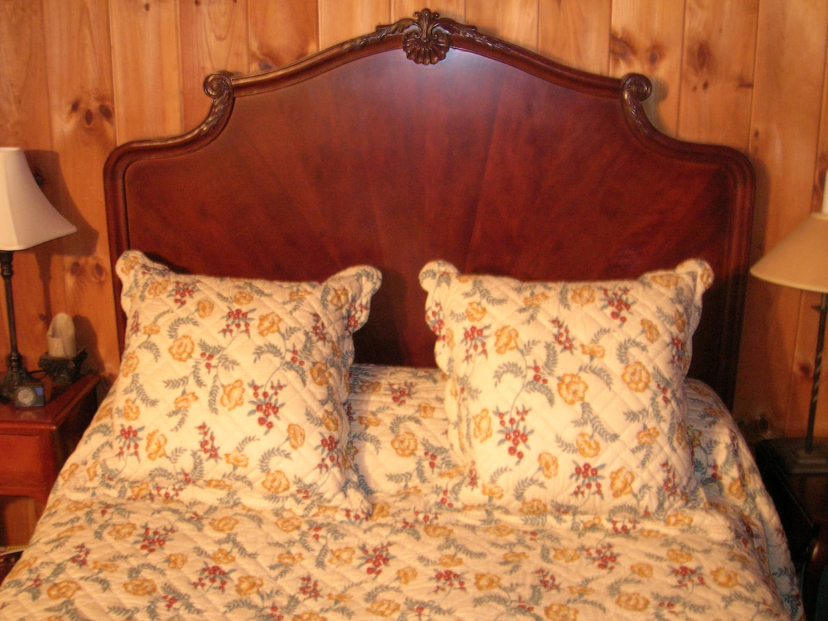 Main bedroom holds a queen bed