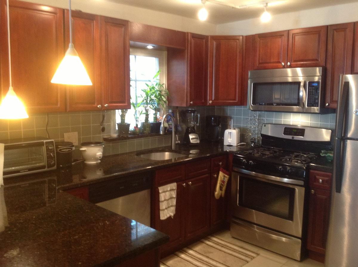 Stainless steel and granite kitchen.