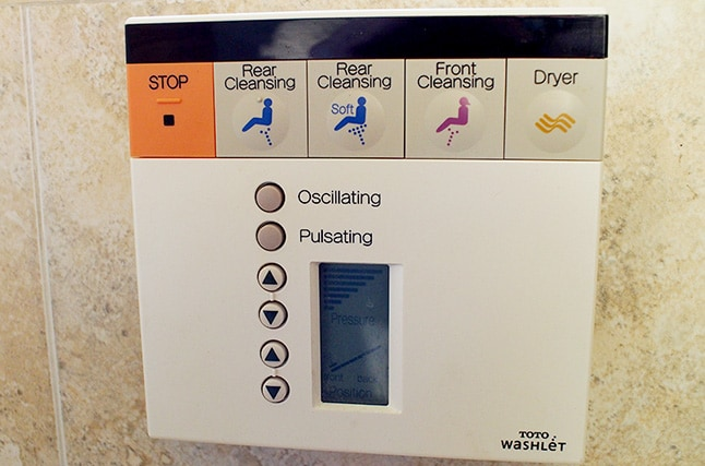 Washlet controller mounted just next to the toilet.