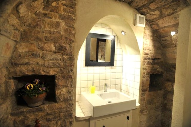 Bathroom: it has been converted from an old fireplace.