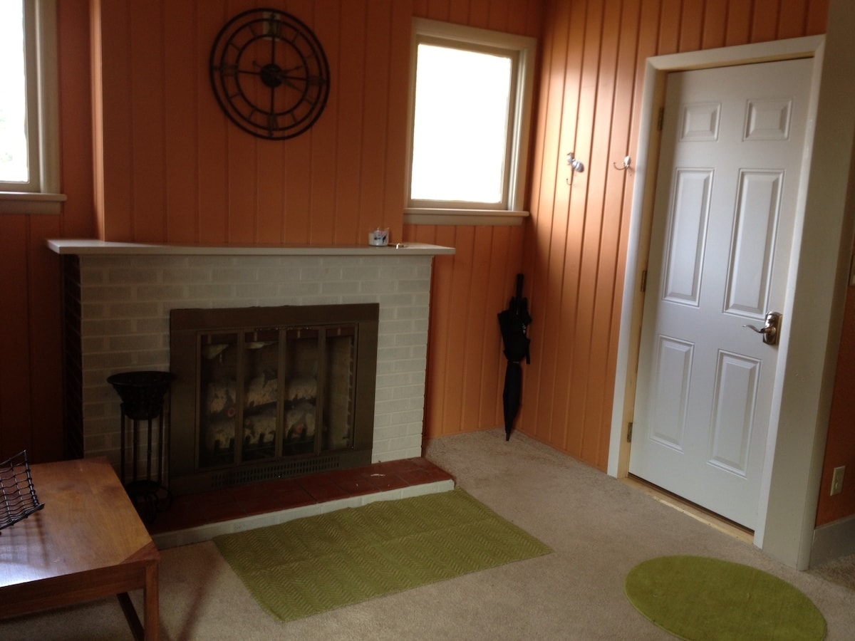 Front entry.  Decorative fireplace.