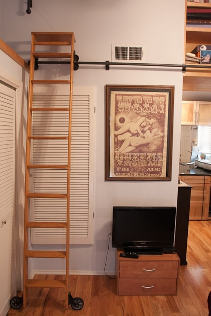 the rolling library ladder will take you over to the high bookcase!