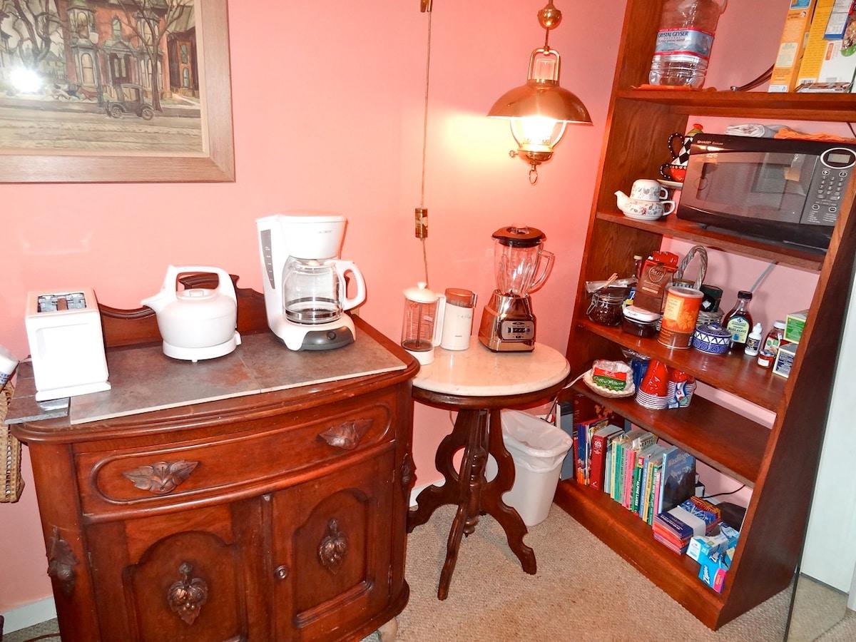 Snack prep area - coffee, tea, cereals, fruit, yogurt, juice, milk, condiments provided