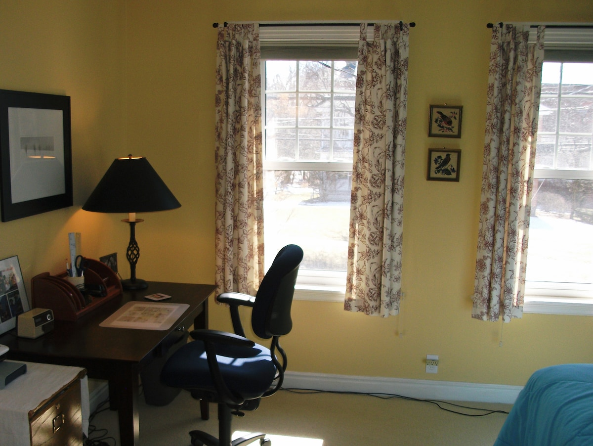 Desk in sunny south-facing guest room.