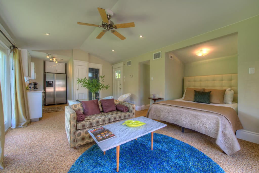 The bungalow features pebble floors & a vaulted ceiling