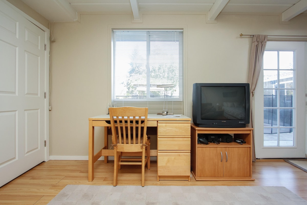 Desk, television, xbox/dvd player in main bedroom