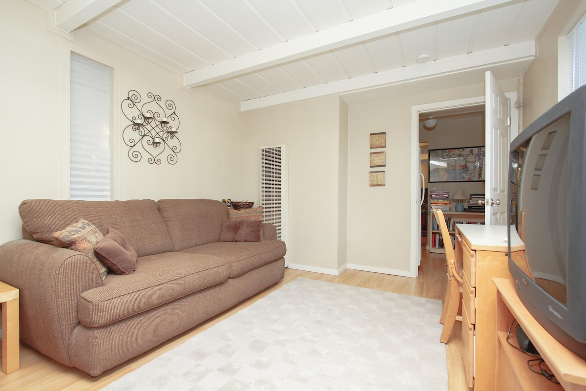 Seating area and desk in main bedroom