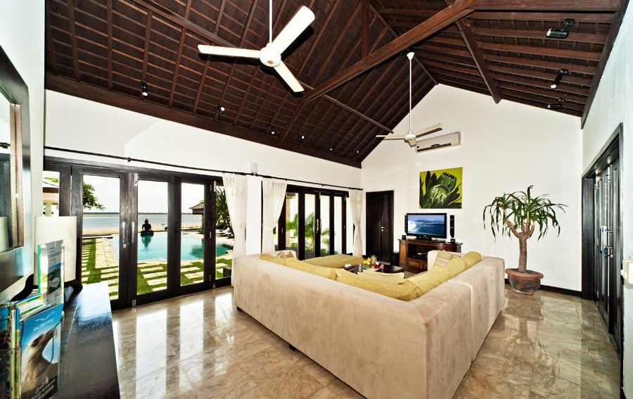 Living area. French doors open to the pool, waterfront view