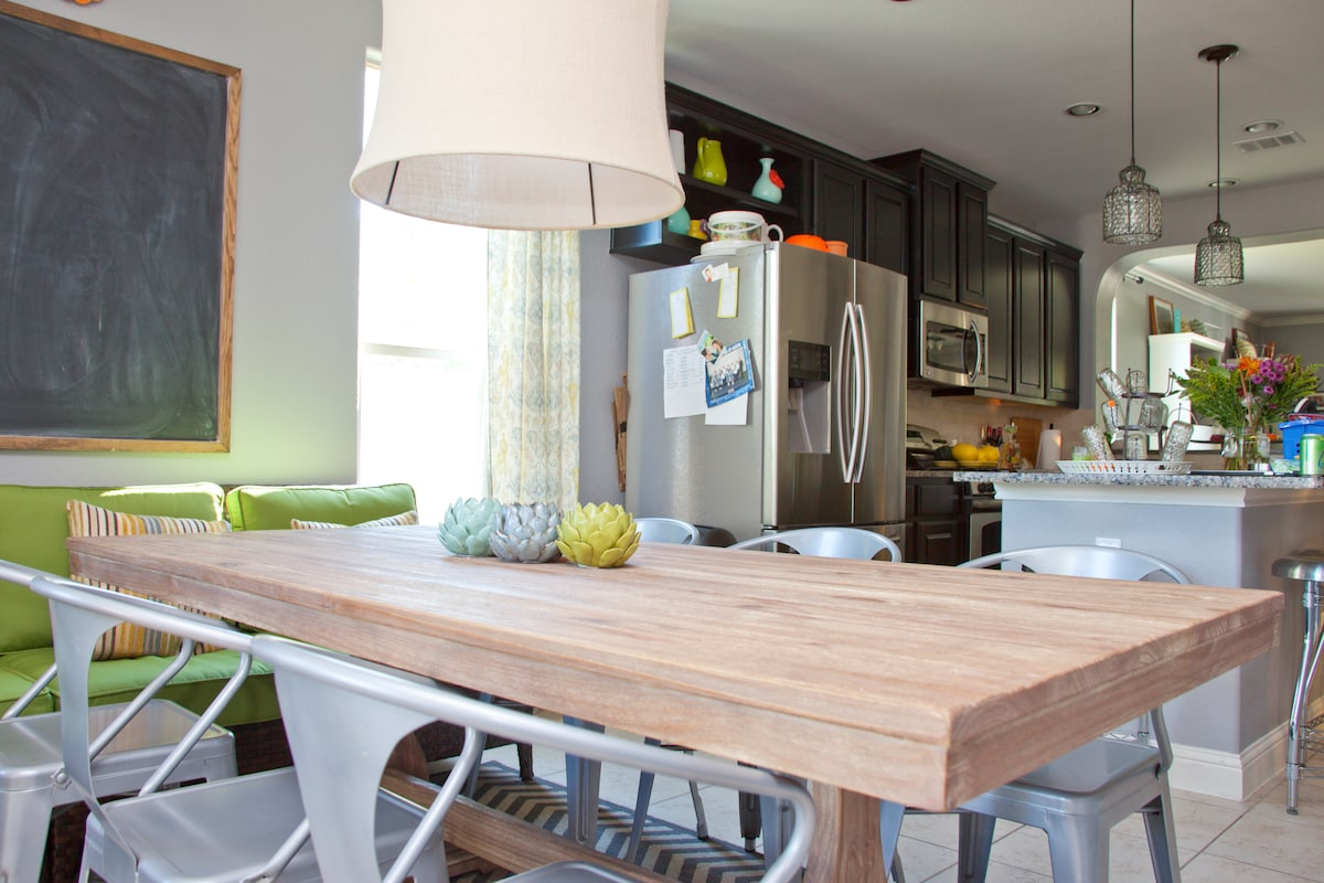 """Kitchen table seats 8, and there is a wrap around """"kitchen couch"""" which accommodates an additional 4 people."""
