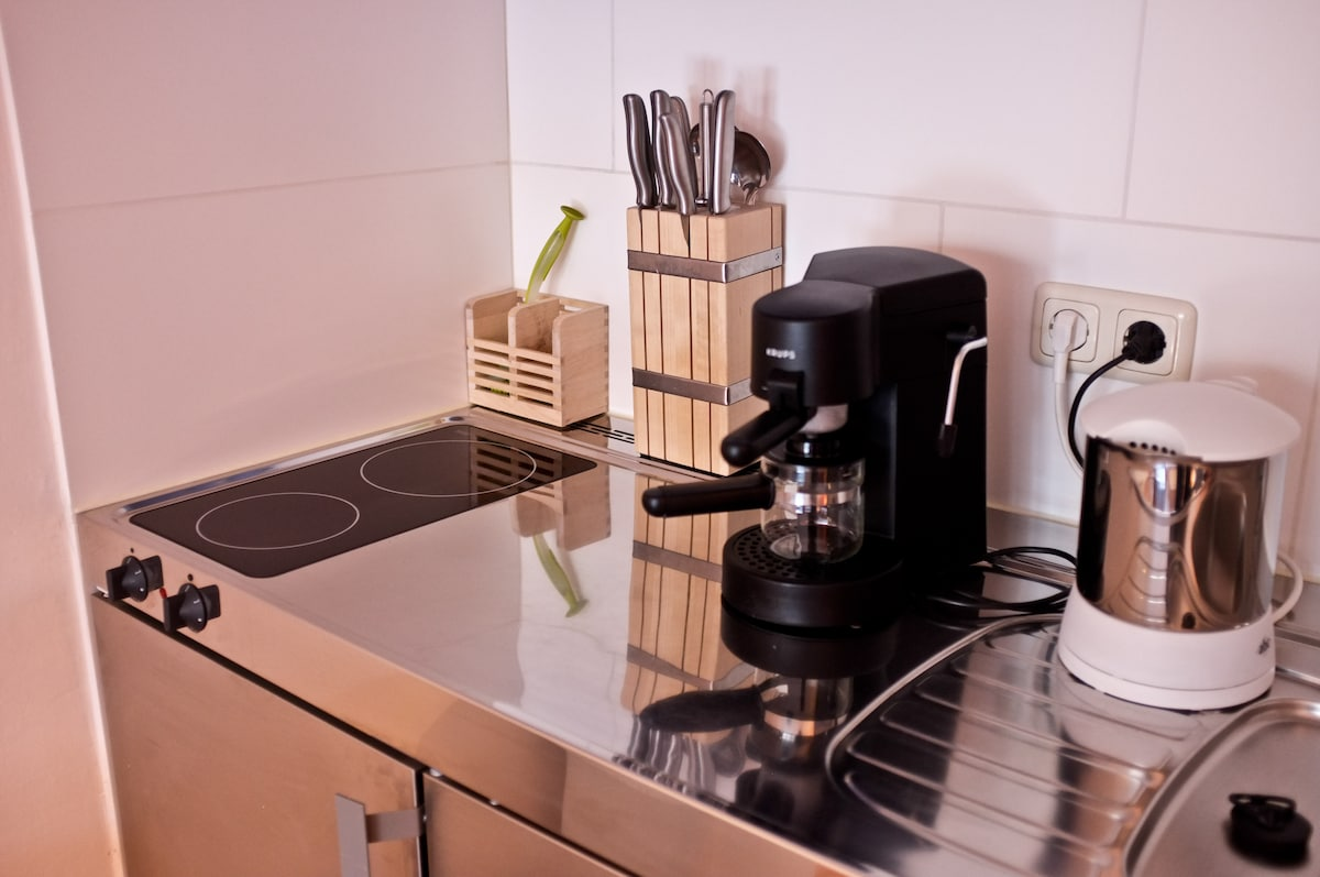 cool chrome kitchen with all stuff you need