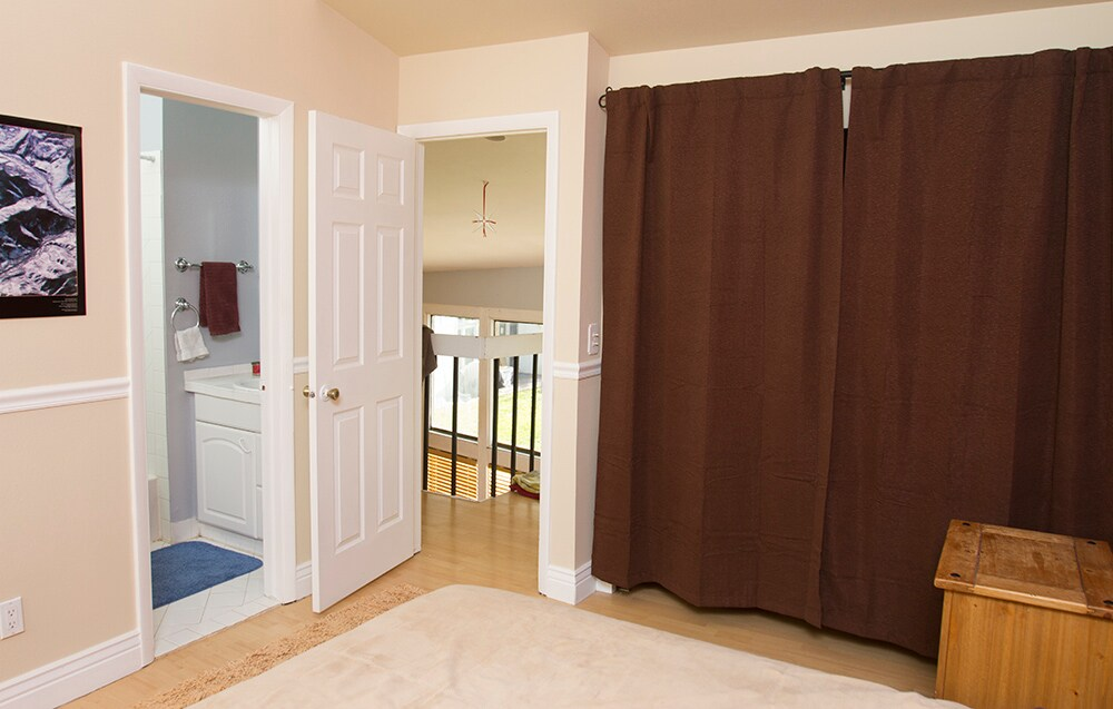 The available bedroom as an attached private bathroom as well as plenty of closet and storage space upstairs in the condo.