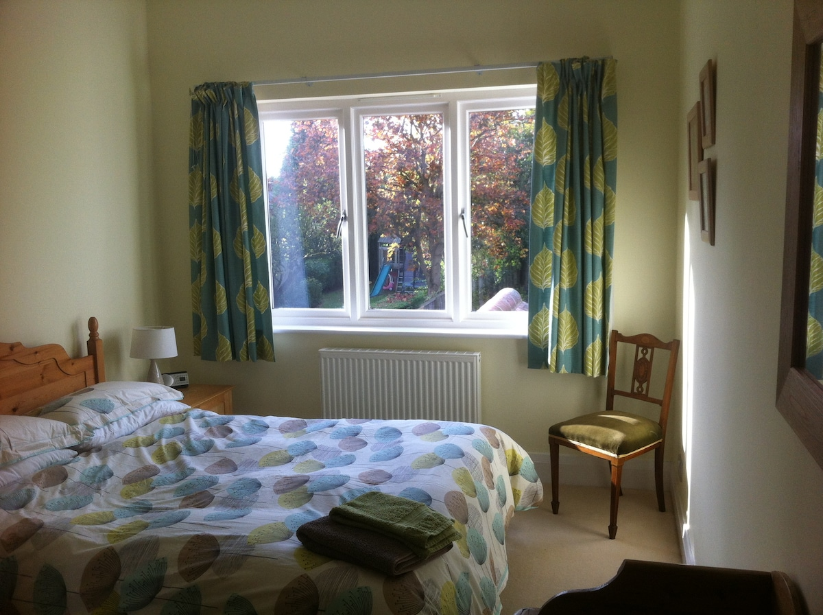 Spacious double room catches the afternoon and evening sun.